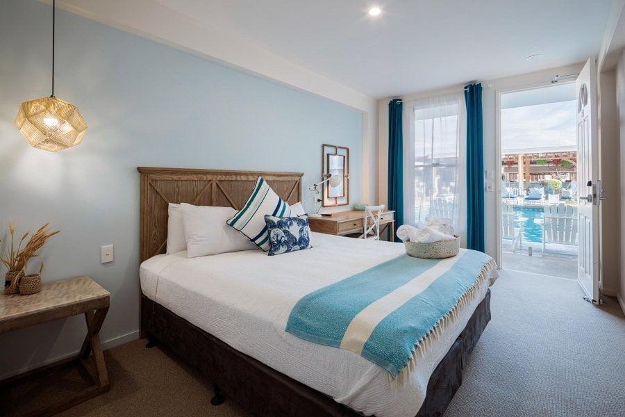 king suite bedroom that's facing poolside